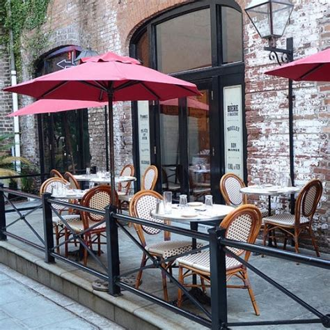 european style cafe chairs and patio umbrellas popular