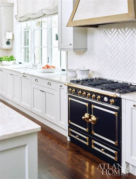 shiny kitchen tiles glam kitchen features white shaker cabinets adorned with 2196