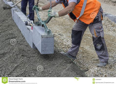 granite curbing installation vertical curbing stock photo