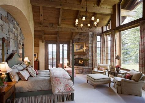 rustic master retreat with fireplace and a lot of windows