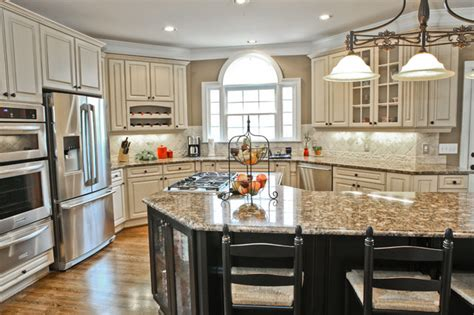 antique white kitchen island creative cabinets and faux finishes llc traditional