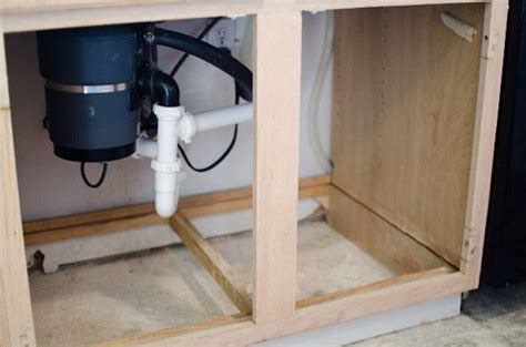 leak kitchen sink cabinet how to replace water damaged cabinet bottom this is a 8929
