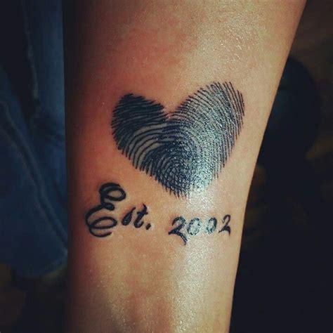 daniels thumb print tattoo thumbprint tattoo