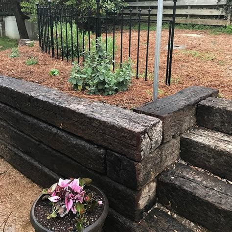 railroad ties for garden we love replacing old cinderblock with railroad ties it s is less expensive and adds character