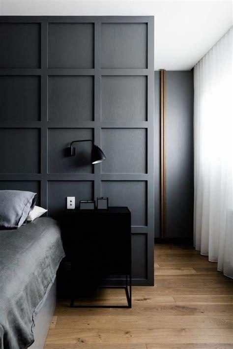 moody dark grey bedroom  square wall panels modern