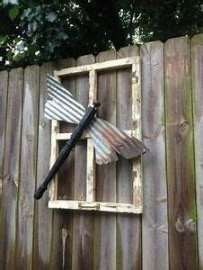 Great way to recycle old fan blades, make flowers for the