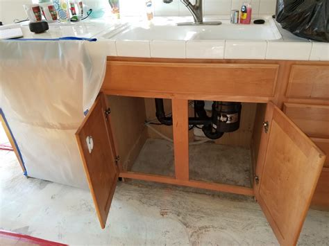 water damaged kitchen cabinets water damage to kitchen cabinets insurance solution was 7012
