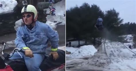"Hilarious Dude ""Sends It"" Off A Homemade Snow Mobile Jump"