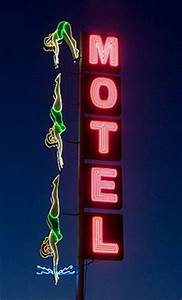 A hotel sign in Mesa AZ A monsoon ripped her down but