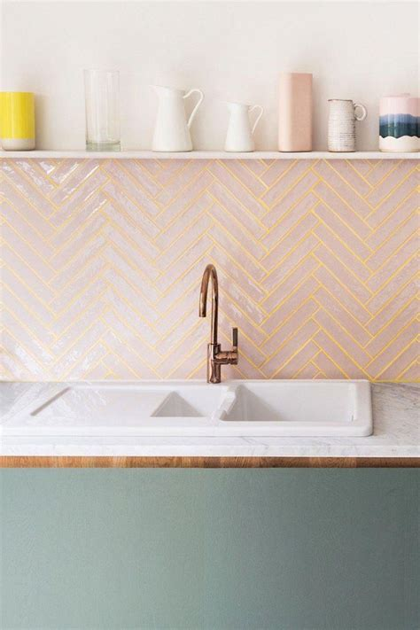 kitchen backsplash  pink tile  yellow grout