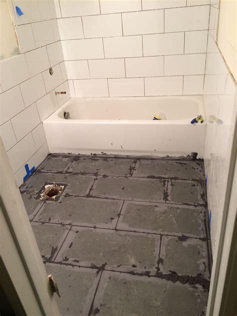 floor grout  white subway tiles  bloc  grey