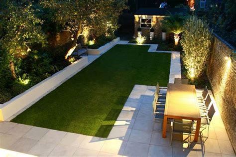 modern backyard landscape house design with green grass in the middle garden surrounded with
