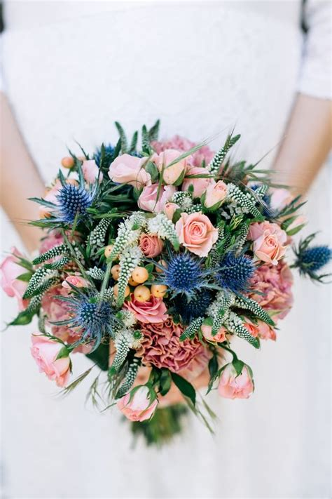 colorful bouquet  pink blooms blue thistles