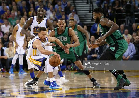 Avery Bradley and Amir Johnson of the Boston Celtics try ...