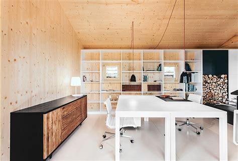 maison moderne en bois design contemporain lambris sol beton cire blanc salle a manger