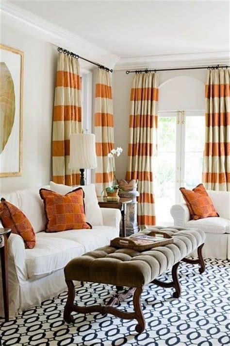 orange striped curtains with blue patterned rug