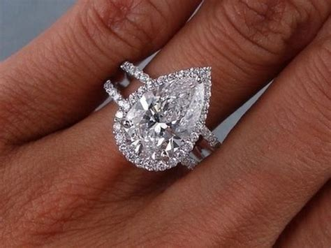 3 Carat Diamond Ring  3 Carat Diamond Ring Round Cut. Dot Bracelet. 24k Bracelet. Sterling Silver Ankle Bracelets. Grey Rings. Amavida Engagement Rings. 3mm Ball Stud Earrings. Symbol Pendant. Sapphire Diamond Bands