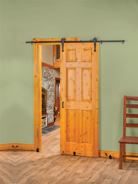 new rolling barn style door hardware creates stylish