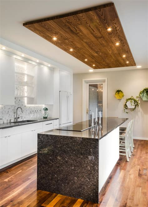 contemporary white kitchen  wood panel ceiling accent