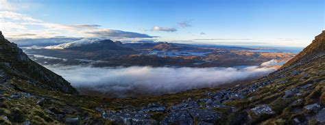 Aerial photography of mountains covered with clouds