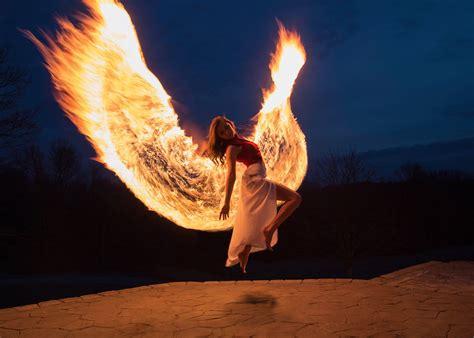 photographer shoots phoenix wings  light painting