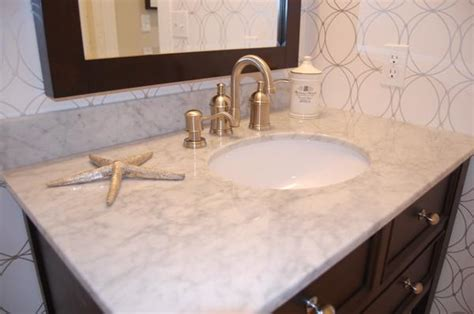white sink  brushed nickel faucet bathrooms