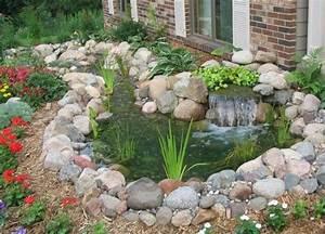 Steine Für Gartenteich : ein gartenteich mit bachlauf und wasserfall umrahmt von steinen wasserg rten pinterest ~ Sanjose-hotels-ca.com Haus und Dekorationen