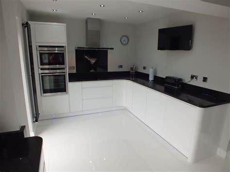 monochrome kitchen  ultra sleek  handleless
