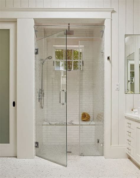 white subway tile shower marble seat glass ventilation