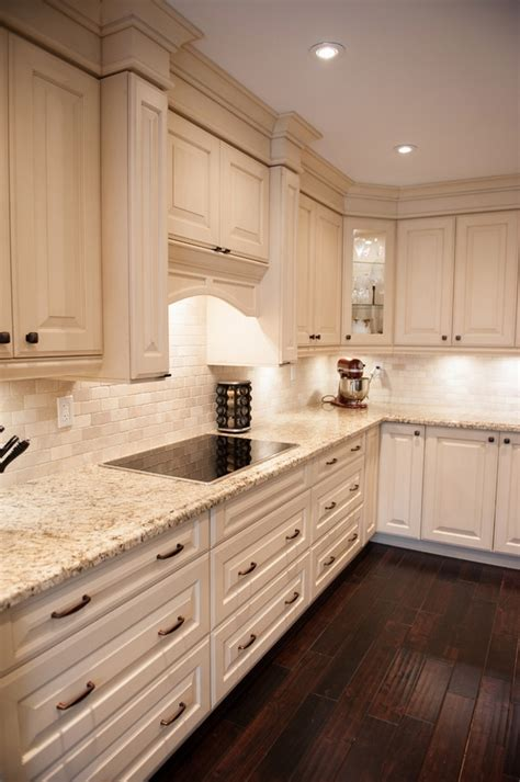 white kitchen cabinets with marble giallo ornamental granite countertops add elegance in the 2069