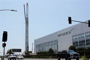 SpaceX displays Falcon 9 rocket as monument outside of HQ ...