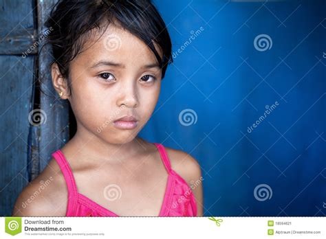 Young Asian Girl In Poverty Over Blue Stock Image Image Of Head Close 18594621