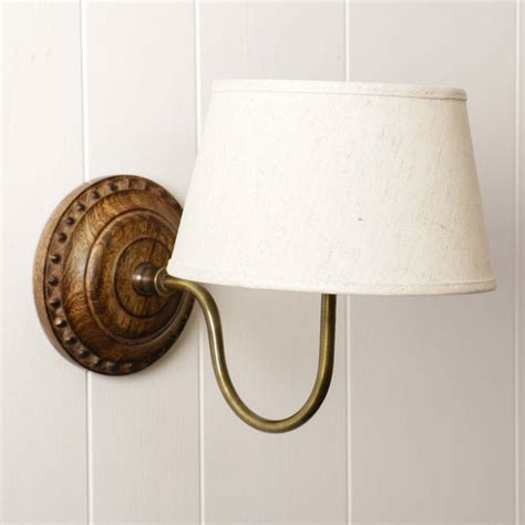 carved wood and brass wall light with linen shade by dibor