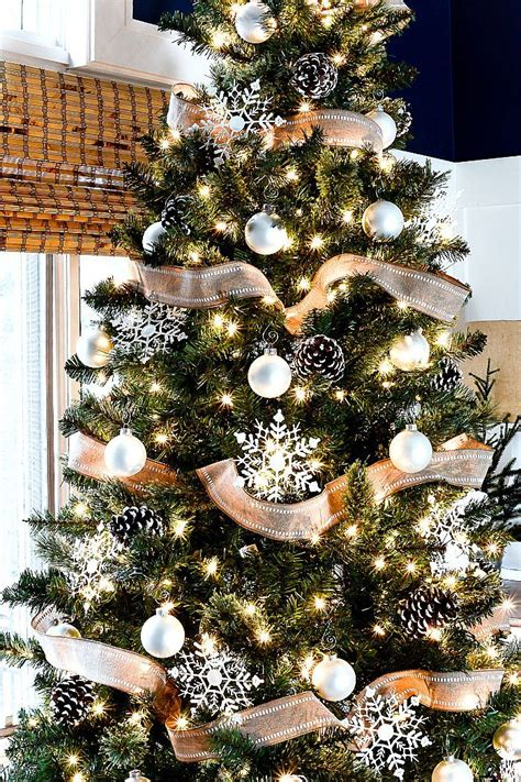 christmas tree  burlap ribbon pine cones christmas