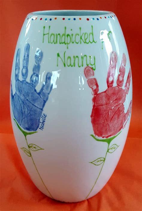 tall vase  grandchildrens handprints turned