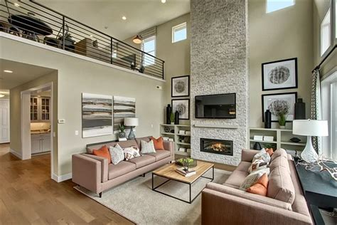 love   story open great room   full height stone fireplace  modern