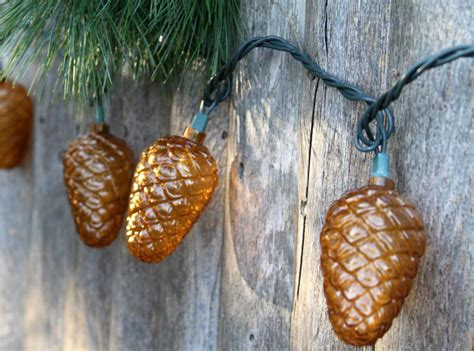 festive fall pinecone string lights the green
