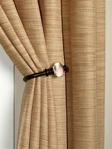 Living room window treatments hgtv for Curtain tie backs placement
