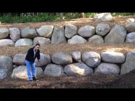 rocks for driveway how to turn a hill into a flat yard with a retaining wall