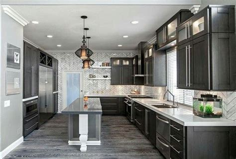 Grey plank tile, dark cabinets, light countertops for