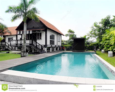 tropical style house  pool  landscaping stock photo image