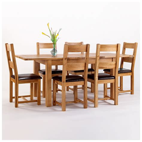 50 rustic oak dining table and 6 chairs extending