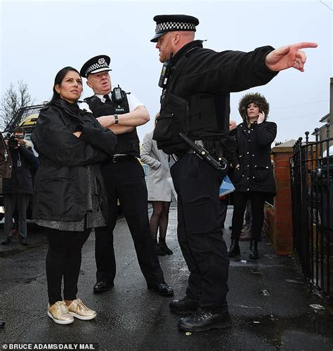 Priti Patel is on front line as officer uses CHAINSAW to ...