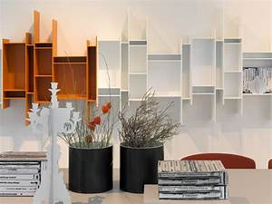 Elegant white and brown varnished modern wall shelves as