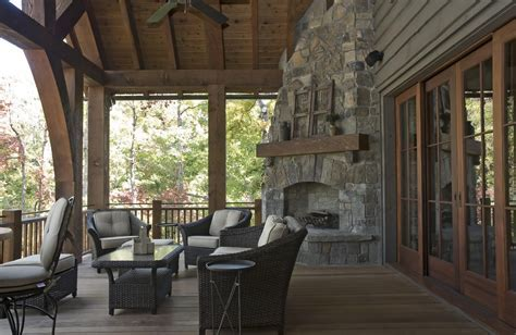 corner outdoor fireplace Porch Rustic with ceiling fan