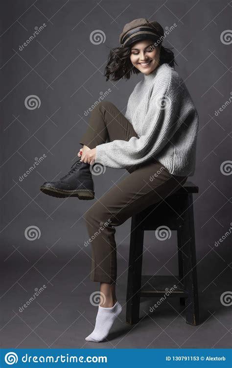 Beautiful Smiling Brunette Girl Wearing A Casual Style