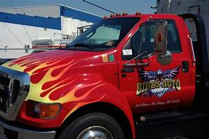 towing truck with custom tribal flames logo with gold With big truck lettering