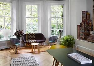 Wohnzimmer Mit Ethno Elementen Stuhl Fensterfront