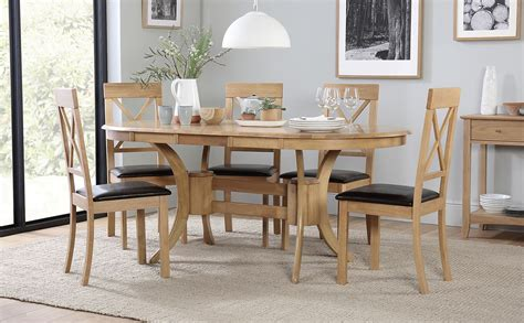 Set includes 1 expansive table and 6 chairs. Townhouse Oval Oak Extending Dining Table with 6 Kendal ...