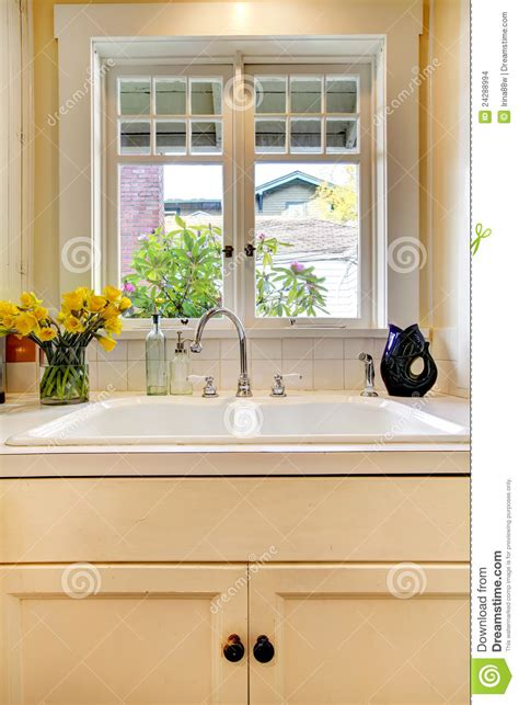 window sink in kitchen kitchen sink and white cabinet with window stock images 1903